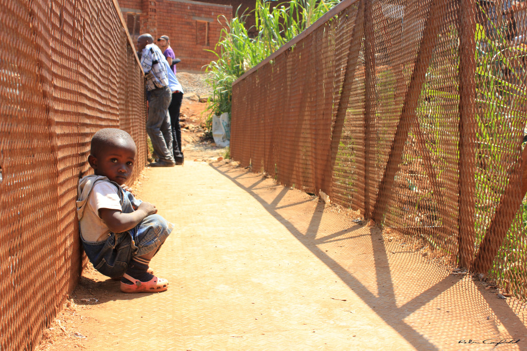 A Boy on the Bridge to Kibera. Nairobi, Kenya.