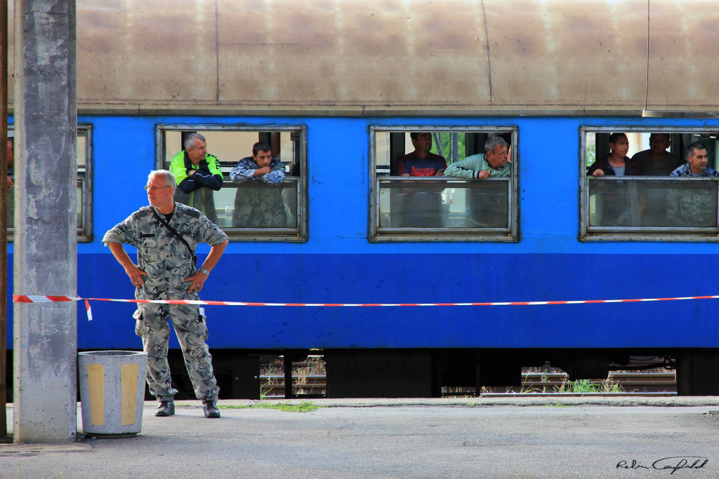 A Furious Officer Stands Waiting. Train Station, Bulgaria.