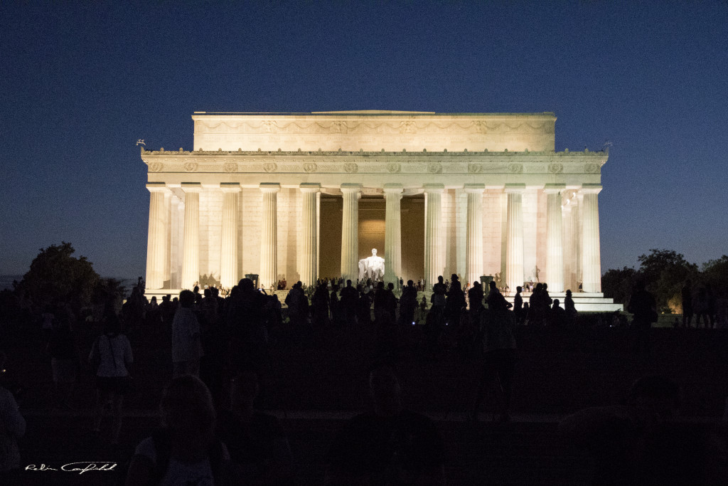 Photographers gather before the Lincoln Memorial at night. Washington, D.C. - August, 2015