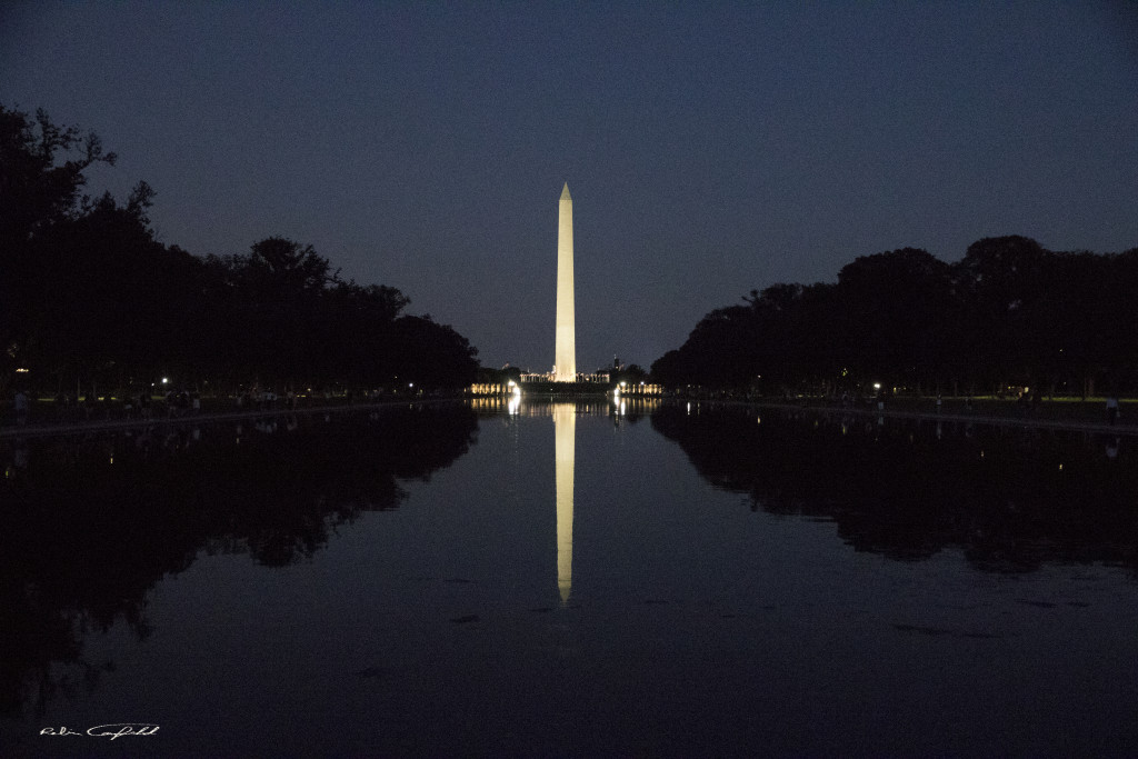 The monument on the reflecting pool by night. Washington, D.C. - August, 2015