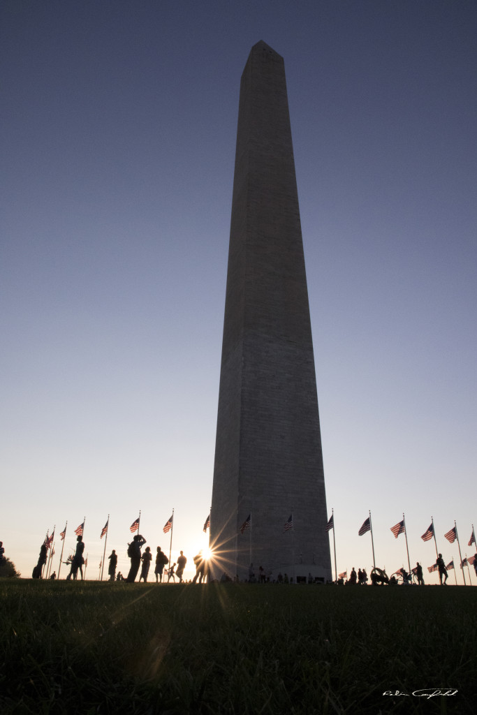 The last rays of sunlight hit the Washington Monument. Washington, D.C. - August, 2015